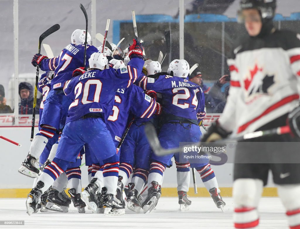 The United States team celebrates after beating Canada during the IIHF World Junior Championship at New Era Field on December 29, 2017 in Buffalo, New York. The United States beat Canada 4-3.
