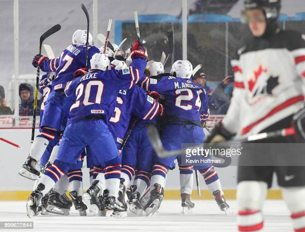 The United States team celebrates after beating Canada during the IIHF World Junior Championship at New Era Field on December 29 2017 in Buffalo New...