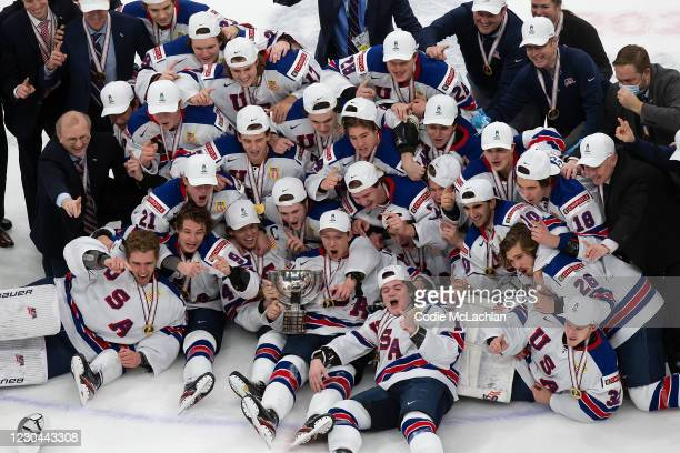 The United States team celebrates its victory over Canada during the 2021 IIHF World Junior Championship gold medal game at Rogers Place on January...