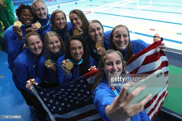 The United States team celebrates their gold medal win after defeating Canada by taking a selfie picture during the Women's Waterpolo Final match...