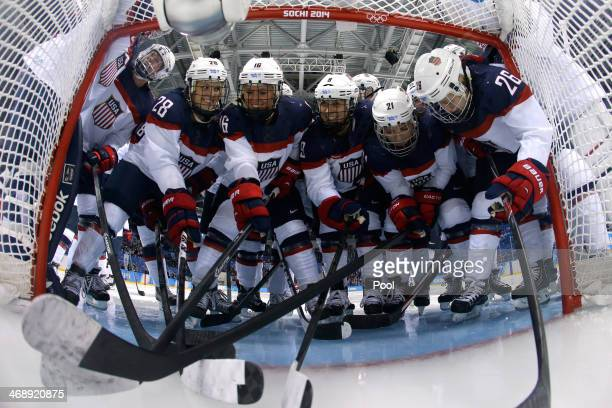 The United States team huddles in front of the net prior to the Women's Ice Hockey Preliminary Round Group A game against Canada on day five of the...