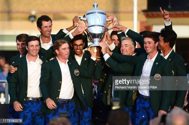 The United States team lift The Walker Cup as they celebrate victory following the singles matches during Day 2 of the Walker Cup at Royal Liverpool...