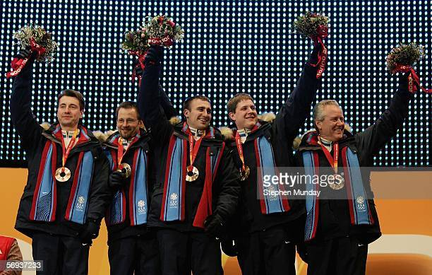 The United States team of Pete Fenson Shawn Rojeski Joe Polo John Shuster and Scott Baird receive the Bronze medal the men's curling at the Medals...