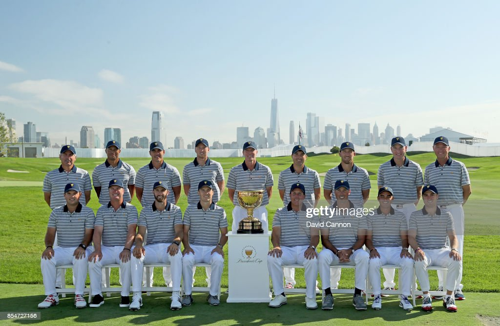 The United States Team pose for the official team photograph (L-R standing) Fred Couples (assisitant captain), Tiger Woods (assistant captain), Brooks Koepka, Daniel Berger, Steve Stricker (captain), Kevin Kisner, Kevin Chappell, Jim Furyk (assistant captain) Davis Love III (assistant captain), (L-R sitting) Patrick Reed, Charley Hoffman, Dustin Johnson, Jordan Spieth, Phil Mickelson, Matt Kuchar, Rickie Fowler, Justin Thomas before practice for the 2017 Presidents Cup at the Liberty Natioanl Golf Club on September 27, 2017 in Jersey City, New Jersey.