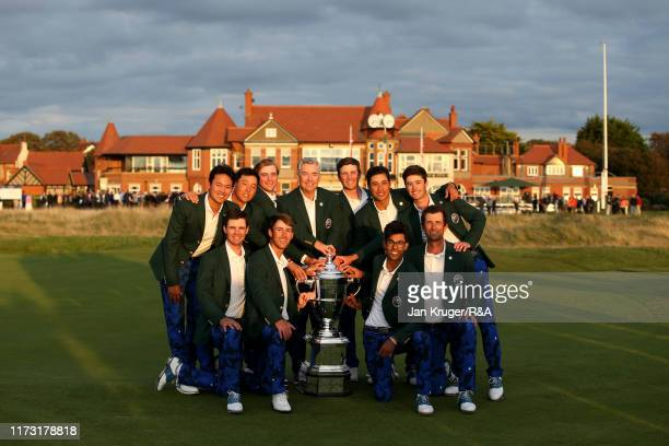 The United States team pose with The Walker Cup as they celebrate victory following the singles matches during Day 2 of the Walker Cup at Royal...