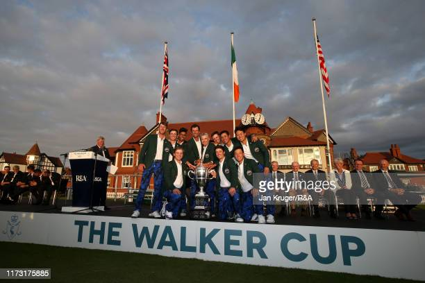 The United States team pose with The Walker Cup following the singles matches during Day 2 of the Walker Cup at Royal Liverpool Golf Club on...