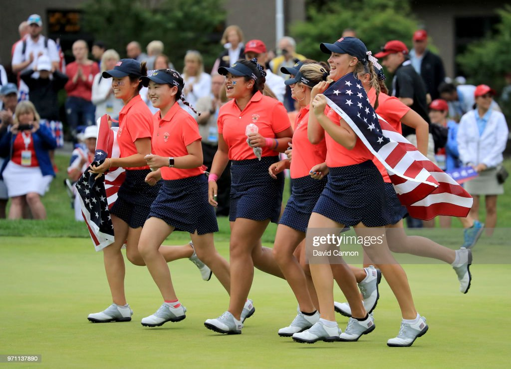 The United States team race onto the 18th green to celebrate after their 17-3 victory over the Gtreat Britain and Ireland team during the final day singles matches in the 2018 Curtis Cup Match at Quaker Ridge Golf Club on June 10, 2018 in Scarsdale, New York.