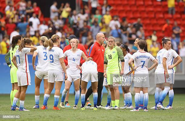 The United States team reacts after their 11 loss to Sweden during the Women's Football Quarterfinal match at Mane Garrincha Stadium on Day 7 of the...