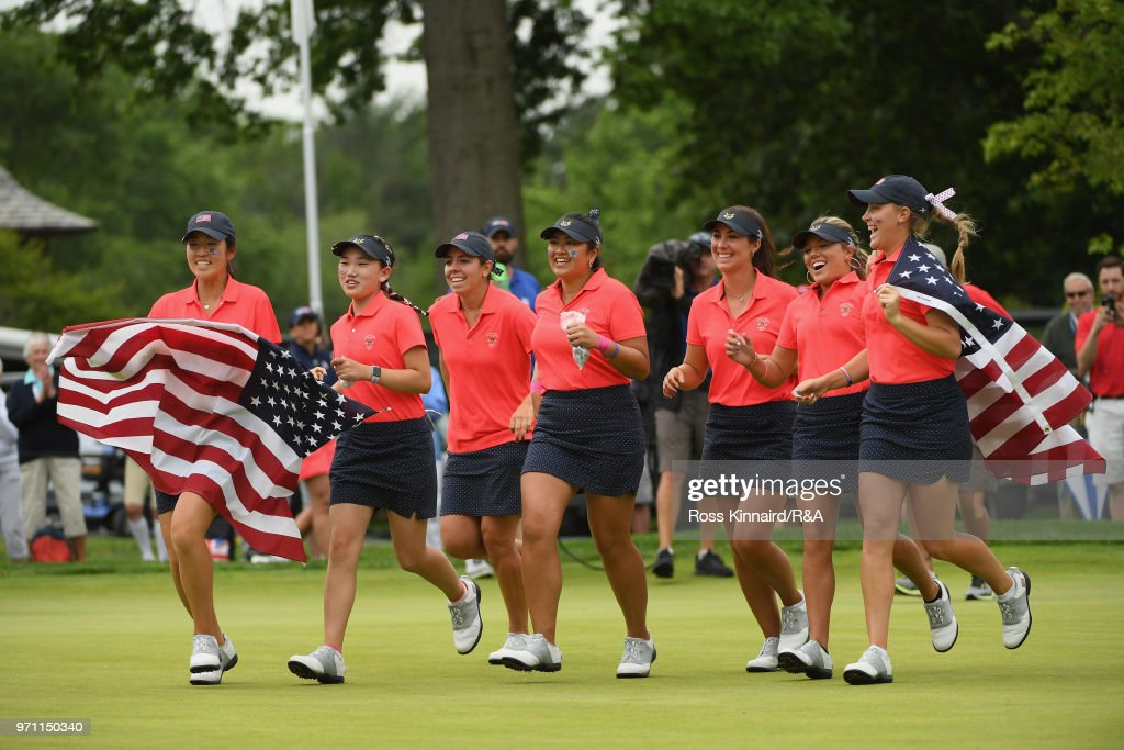 The United States team runs onto the 18th green after defeating the Great Britain and Ireland team 17-3 on day three of the 2018 Curtis Cup Match at Quaker Ridge Golf Club on June 10, 2018 in Scarsdale, New York.