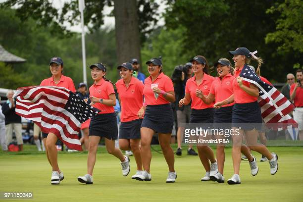 The United States team runs onto the 18th green after defeating the Great Britain and Ireland team 173 on day three of the 2018 Curtis Cup Match at...