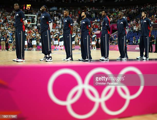 The United States team stands during the national anthem before taking on Argentina in the Men's Basketball semifinal match on Day 14 of the London...