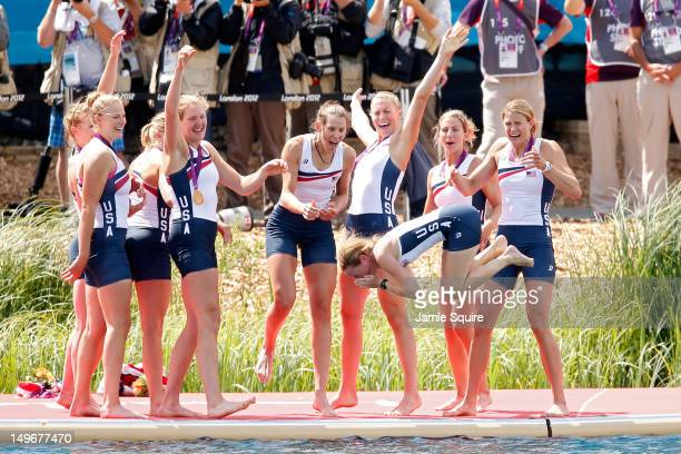 The United States team throw their cox Mary Whipple into the water as they celebrate with their gold medals during the medal ceremony after the...