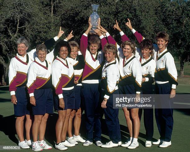 The United States team with the trophy after winning the Solheim Cup golf competition held at the Lake Nona Golf and Country Club Florida 18th...