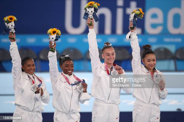 The United States team with their silver medals on the podium, Jordan Chiles, Simone Biles, Grace. McCallum and Sunisa Lee, during the Team final for...