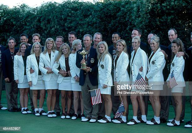 The United States team with their wives and partners and the trophy after the United States team wins the Ryder Cup golf competition held at the...