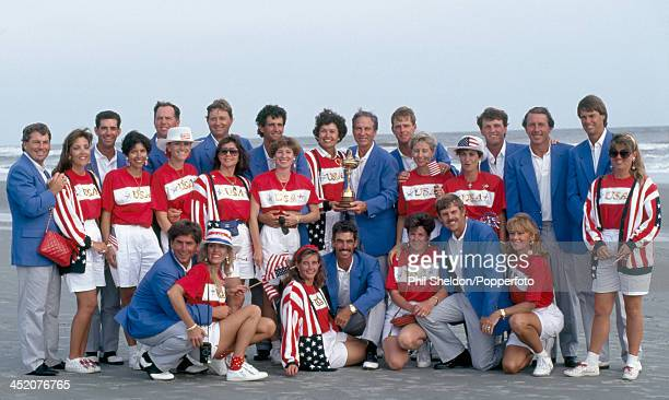The United States team with their wives and the trophy after winning the Ryder Cup golf competition held at the Kiawah Island Golf Resort, South...