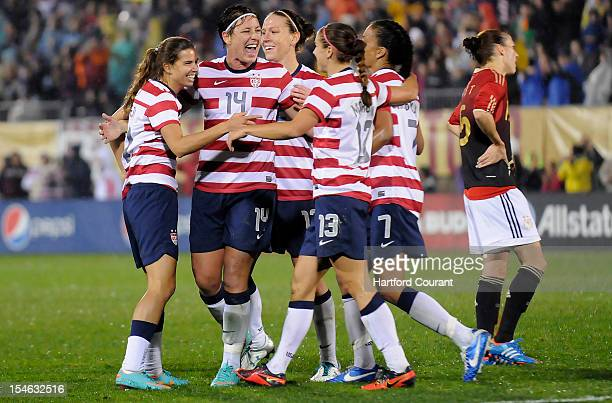 The United States' Tobin Heath Abby Wambach Lauren Chaney Alex Morgan and Shannon Box celebrate after Heath scored during the second half against...