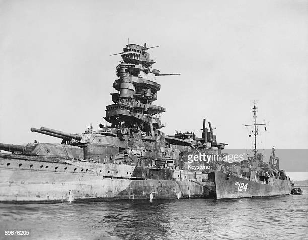 The United States transport 'USS Horace A Bass' moored alongside the 'Nagato' a battleship of the Imperial Japanese Navy at Yokosuka Naval Base at...