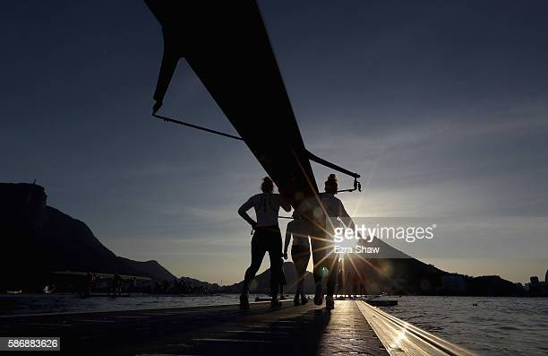 The United States' women's eight bring their boat to the water to warm up prior to the rowing on Day 2 of the Rio 2016 Olympic Games at the Lagoa...