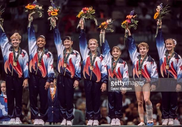 The United States Women's Gymnastics Team of Amanda Borden Dominique Dawes Amy Chow Jaycie Phelps Dominique Moceanu Kerri Strug and Shannon Miller...