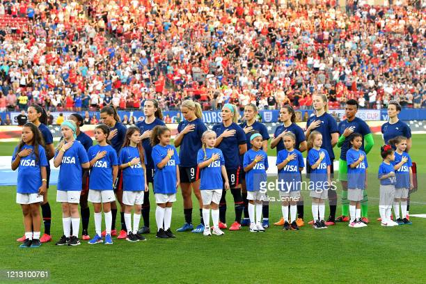 The United States women's national team stand during the national anthem with their tops turned inside out as part of the team's equal pay campaign...