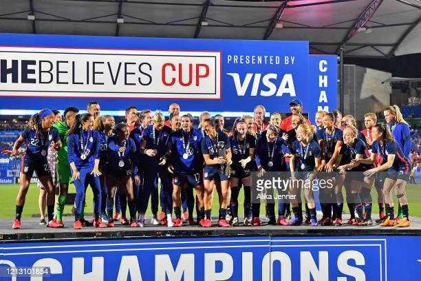 The United States women's national team stand on the championship stage after the SheBelieves Cup match against Japan at Toyota Stadium on March 11...