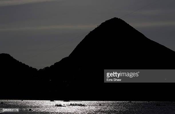 The United States women's quad skull and women's eight warm up prior to the rowing on Day 2 of the Rio 2016 Olympic Games at the Lagoa Stadium on...