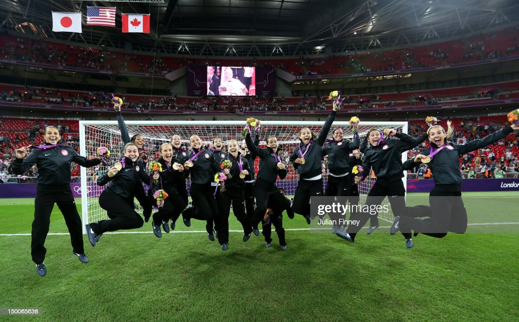 The United States women's soccer team celebrates with the the gold medal after defeating Japan by a score of 2-1 to win the Women's Football gold medal match on Day 13 of the London 2012 Olympic Games at Wembley Stadium on August 9, 2012 in London, England.