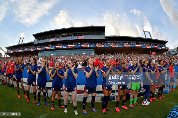 The United States women's soccer team clap after the singing of the national anthem before the SheBelieves Cup match against the Japan at Toyota...