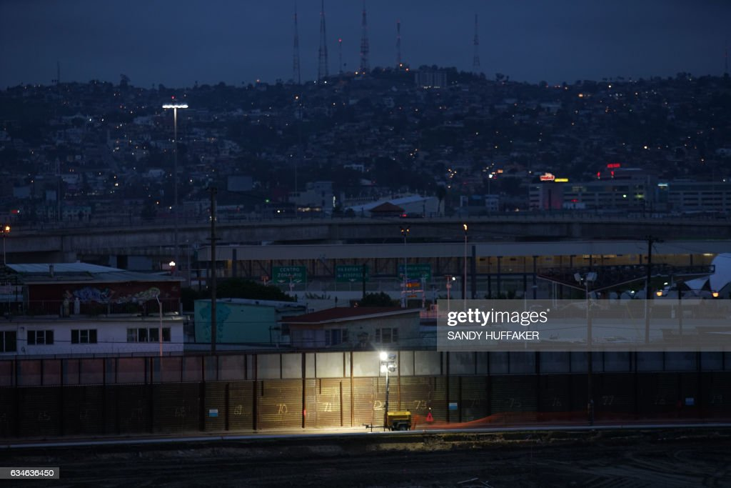 The United States-Mexico Border wall near the San Ysidro Port of Entry in San Ysidro, California on Friday, February 10, 2017. US Department of Homeland Security (DHS) Secretary John Kelly visited the San Ysidro Port of Entry February 10, 2017 in San Ysidro, California. / AFP / Sandy Huffaker