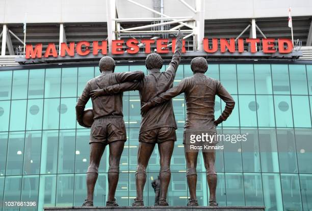 The United Trinity statue is seen outside the ground prior to the Premier League match between Manchester United and Wolverhampton Wanderers at Old...