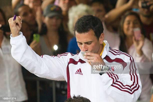 The Unity candidate Henrique Capriles greets after vote in Santo Tomas de Villanueva school on April 14 2013 in Caracas Venezuela