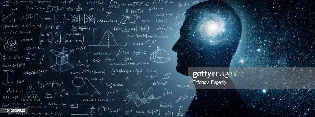 The universe within. Silhouette of a man inside the universe, physical and mathematical formulas.. : Stock Photo