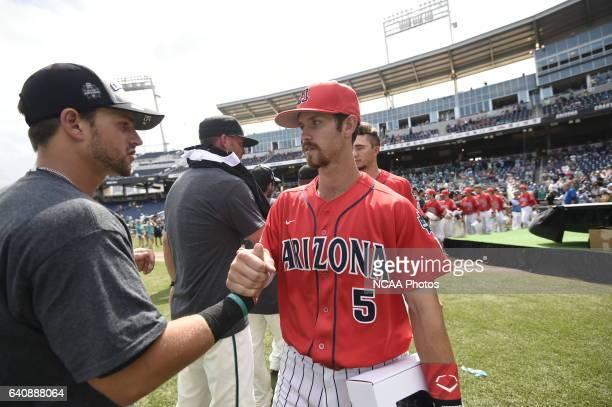 The University of Arizona Wildcats and Coastal Carolina Chanticleers show sportsmanship after Game 3 of the Division I Men's Baseball Championship...