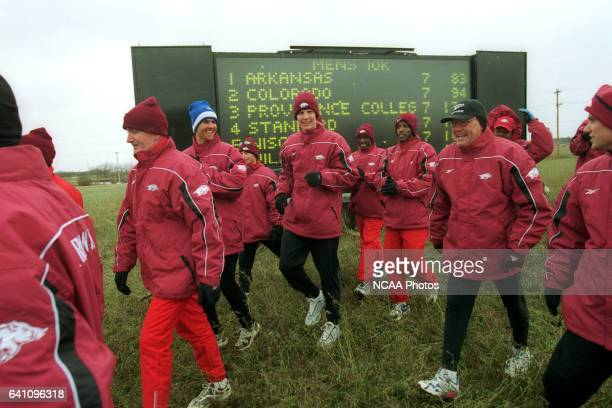 The University of Arkansas team celebrate their team victory during the Men's Division 1 Cross Country Championship held at the Iowa State University...