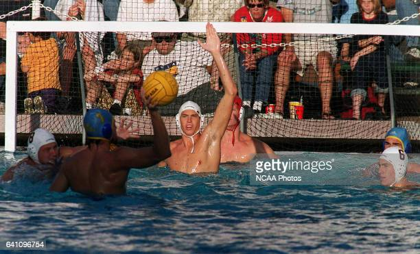 The University of California at San Diego team defends a shot on goal by UCLA's Matt Flesher during the Division I Men's Water Polo Championship held...