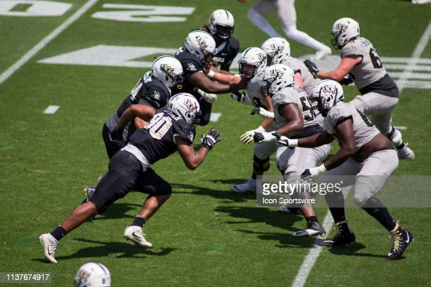 The University of Central Florida offensive and defensive lines clash in the UCF Football Spring Game on April 13 at Spectrum Stadium in Orlando...