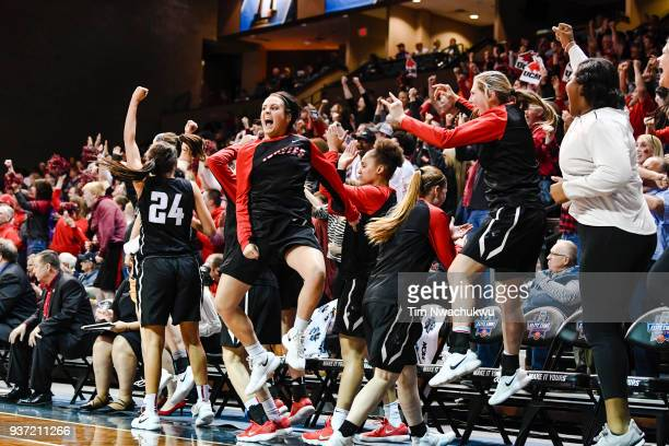 The University of Central Missouri bench cheers during the Division II Women's Basketball Championship held at the Sanford Pentagon on March 23 2018...