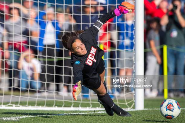 The University of Central Missouri's goalie Ana Dilkes dives for the ball during penalty kicks the Division II Women's Soccer Championship held at...