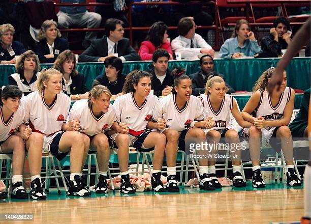 The University of Connecticut bench leans forward in anticipation during the last seconds of the championship game victory against the University of...