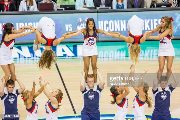 The University of Connecticut cheerleaders form a pyramid during the National Championship game The University of Connecticut Huskies defeated the...