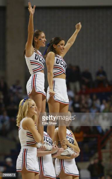 The University of Connecticut Huskies cheerleaders performs during a break in the game against the Georgetown Hoyas on January 14, 2004 at the Gampel...