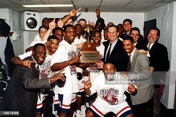 The University of Connecticut men's basketball team celebrates in the lockerroom after wining the 1998 Big East men's basketball championship, New...