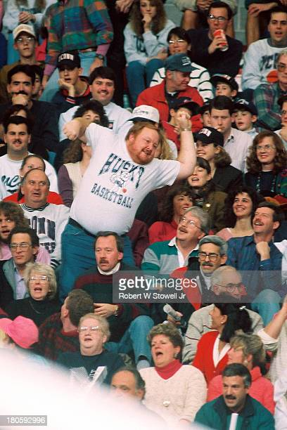 The University of Connecticut men's basketball team's number one fan a bearded figure known as 'Big Red' leads the crowd in a cheer Storrs...