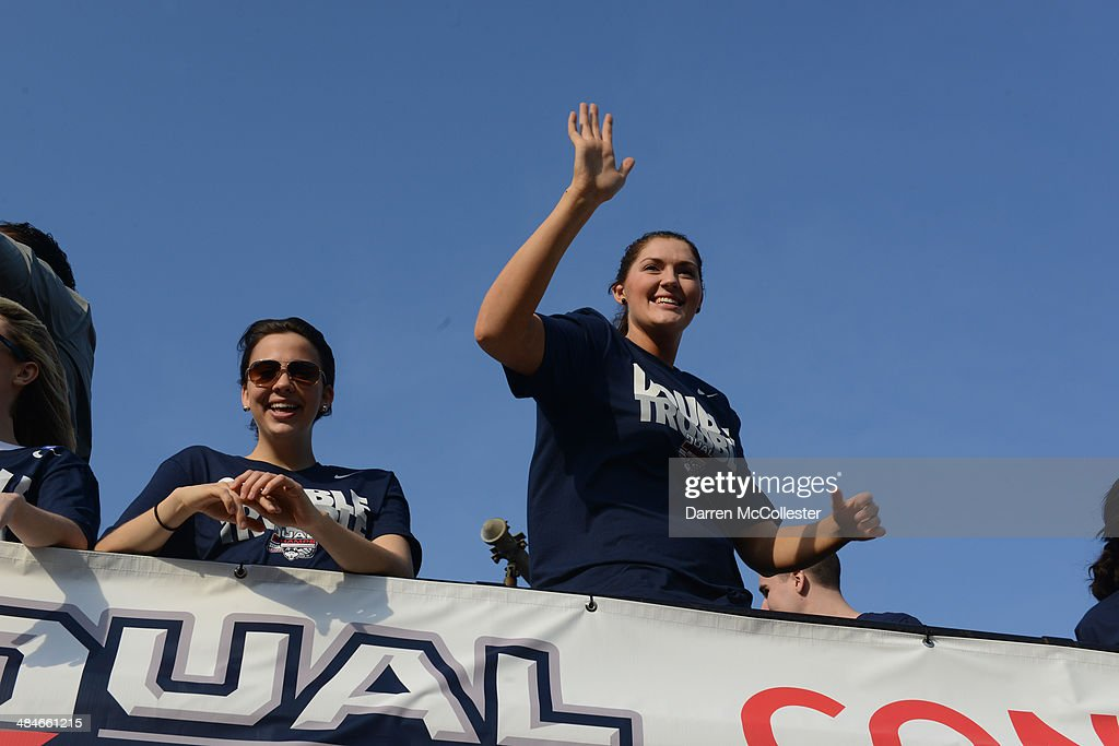 The University of Connecticut women's basketball team ride in a victory parade to celebrate their national championship April 13, 2014 in Hartford, Connecticut. This year was the second time both the men's and women's Uconn basketball teams have won national championships in the same year.