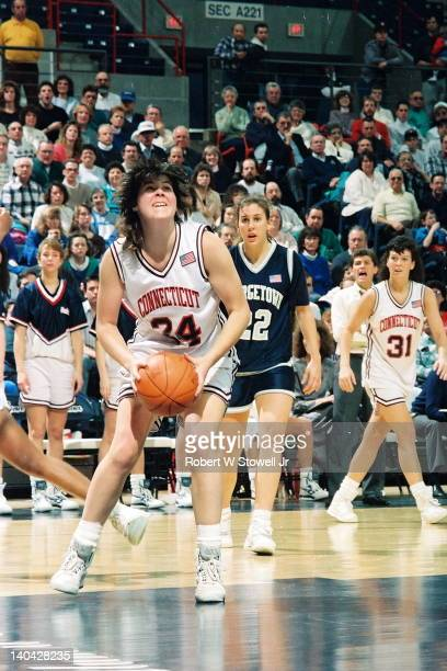 The University of Connecticut's Kerry Bascomb drives against Georgetown, Storrs, CT, 1990.