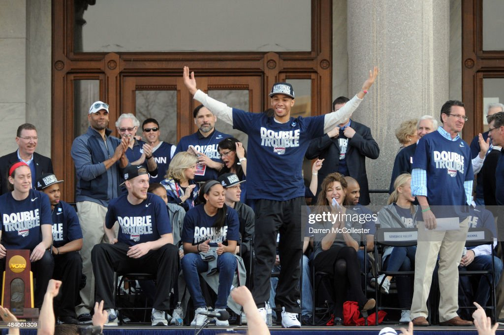 The University of Connecticut's Shabazz Napier pumps up the crowd during a rally to celebrate their national championship April 13, 2014 in Hartford, Connecticut. This year was the second time both the men's and women's Uconn basketball teams have won national championships in the same year.