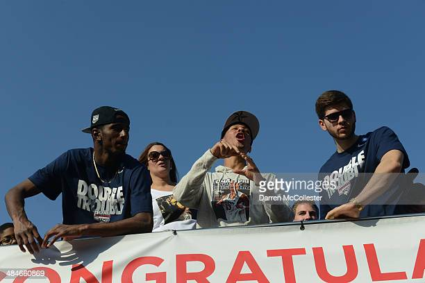 The University of Connecticut's Shabbaz Napier DeAndre Daniels and Leon Tolksdorf ride in a victory parade to celebrate their team's national...