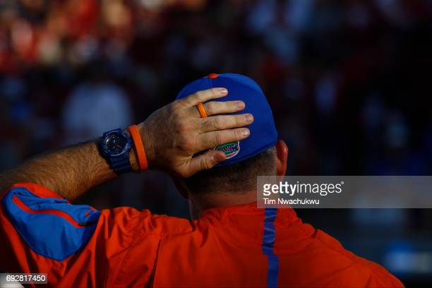 The University of Florida head coach Tim Walton scratches his ball cap as his team takes on the University of Oklahoma during the Division I Women's...