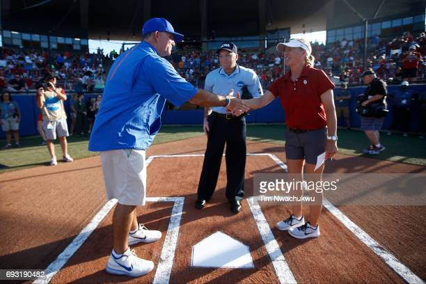 The University of Florida head coach Tim Walton shakes hands with the University of Oklahoma head coach Patty Gasso before Game 2 of the Division I...